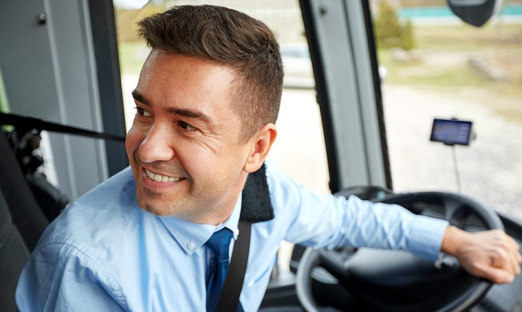 transport, tourism, road trip and people concept - happy driver driving intercity bus