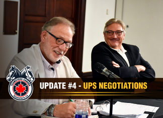 From left to right: Richard Eichel, director of the Teamsters Canada Parcel Division, and François Laporte, president of Teamsters Canada, during UPS negotiations in Quebec City.